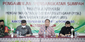 JALANKAN TUGAS. Sejumlah anggota ATR/BPN dan perwakilan desa dikukuhkan untuk menjalankan tugas penyelesaian PTSL